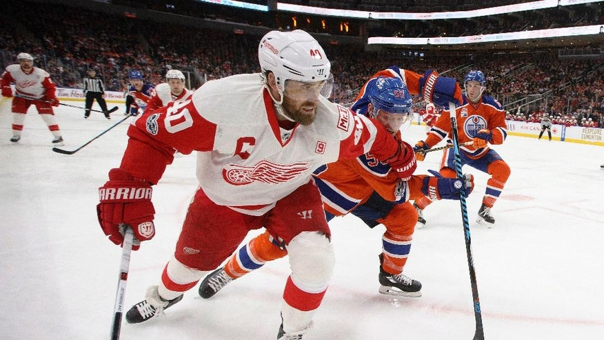 Detroit Red Wings' Henrik Zetterberg (40) and Edmonton Oilers' Mark Letestu (55) race for the puck during the second period of an NHL hockey game Saturday, March 4, 2017, in Edmonton, Alberta. (Jason Franson/The Canadian Press via AP)