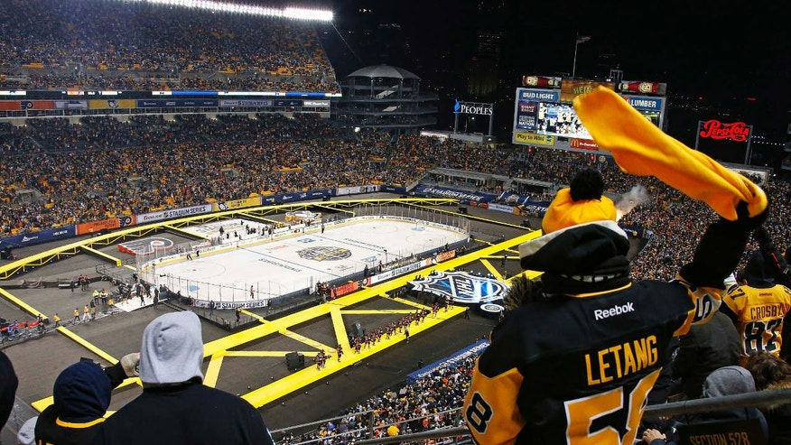 The Pittsburgh Penguins are introduced before an NHL Stadium Series hockey game at Heinz Field against the Philadelphia Flyers in Pittsburgh, Saturday, Feb. 25, 2017.