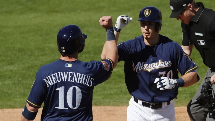 Milwaukee Brewers' Ryan Cordell (70) is congratulated by teammate Kirk Nieuwenhuis after hitting a two-run home run during a spring training baseball game against the Los Angeles Dodgers Sunday, Feb. 26, 2017, in Phoenix. (AP Photo/Morry Gash)