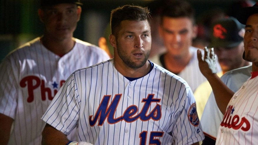 Scottsdale Scorpions left fielder Tim Tebow (15), of the New York Mets organization, in the dugout during a game against the Salt River Rafters on October 12, 2016 at Scottsdale Stadium in Scottsdale, Arizona. Salt River defeated Scottsdale 6-4. (Mike Janes/Four Seam Images via AP)