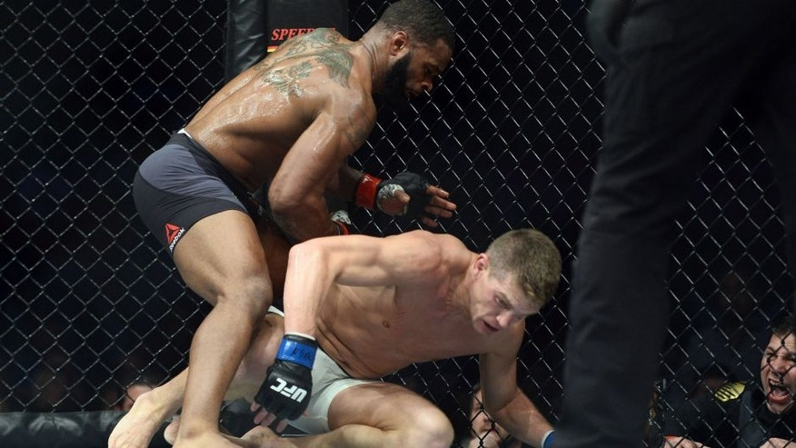 Mar 4, 2017; Las Vegas, NV, USA; Tyron Woodley (red gloves) and Stephen Thompson (blue gloves) fight during their welterweight championship bout at UFC 209 at T-Mobile Arena. Woodley won via majority decision. Mandatory Credit: Joe Camporeale-USA TODAY Sports