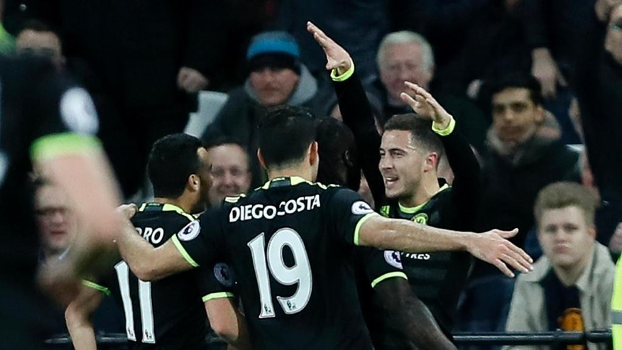 Chelsea's Eden Hazard, right, is congratulated by teammates after scoring a goal during the English Premier League soccer match between West Ham and Chelsea at London Stadium, Monday, March 6, 2017. (AP Photo/Kirsty Wigglesworth)