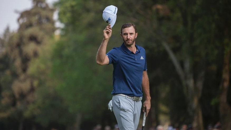 Dustin Johnson, of the United States, celebrates winning the Mexico Championship at Chapultepec Golf Club in Mexico City, Sunday, March 5, 2017. Johnson won the Mexico Championship in his debut as the No. 1 player in the world. (AP Photo/Christian Palma)
