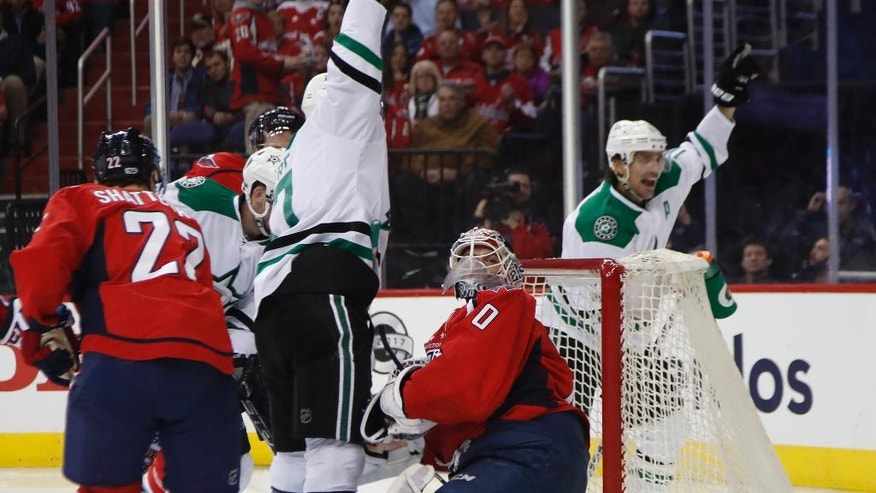 Dallas Stars center Devin Shore, center, celebrates his score with teammate Dallas Stars left wing Patrick Sharp (10), during the first period of an NHL hockey game in Washington, Monday, March 6, 2017. Washington Capitals goalie Braden Holtby (70) watches. (AP Photo/Manuel Balce Ceneta)