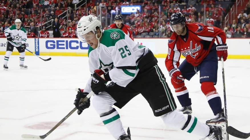 Dallas Stars right wing Brett Ritchie (25) skates away with the puck while Washington Capitals right wing Brett Connolly (10) chases during the first period of an NHL hockey game in Washington, Monday, March 6, 2017. (AP Photo/Manuel Balce Ceneta)
