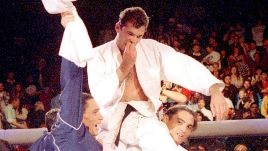 DENVER, CO - NOVEMBER 12: Royce Gracie (USA), 4th-degree Jiu-Jitsu Black Belt, is lifted by members of his corner after beating Gerard Gordeau (NET) to win the Ultimate Fighting Championships UFC 1 on November 12, 1993 at the McNichols Sports Arena in Denver, Colorado. (Photo by Holly Stein/Getty Images)