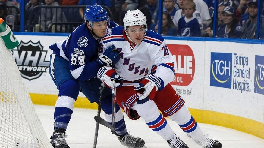 New York Rangers' Jimmy Vesey avoids a check from Tampa Bay Lightning's Jake Dotchin during the first period of an NHL hockey game Monday, March 6, 2017, in Tampa, Fla. (AP Photo/Mike Carlson)