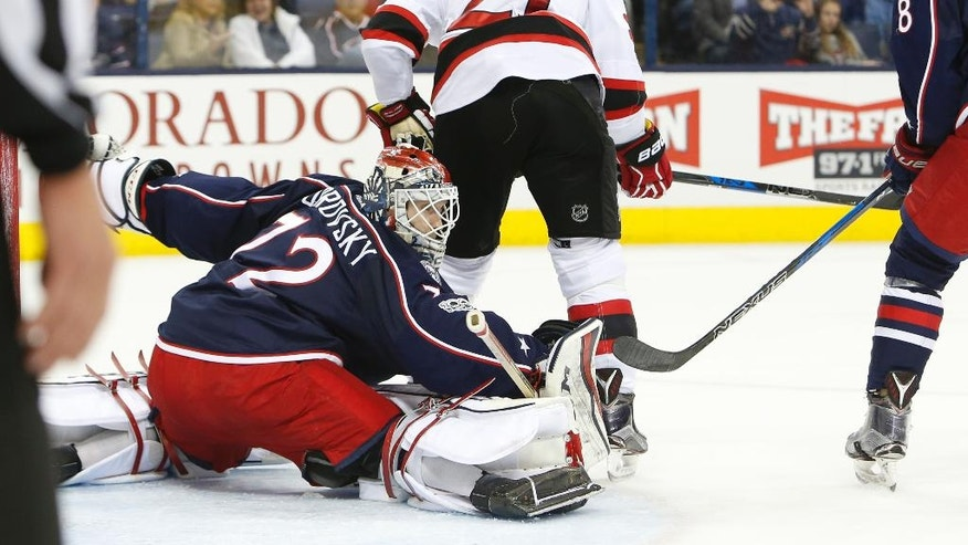 Columbus Blue Jackets' Sergei Bobrovsky, left, of Russia, makes a save against the New Jersey Devils during the first period of an NHL hockey game Tuesday, March 7, 2017, in Columbus, Ohio. The Blue Jackets defeated the Devil 2-0. (AP Photo/Jay LaPrete)