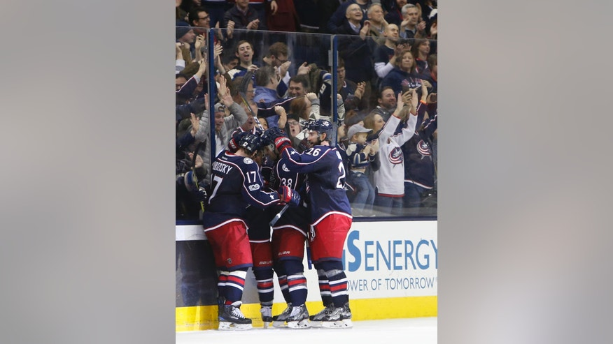 Columbus Blue Jackets players celebrate their goal against the New Jersey Devils during the third period of an NHL hockey game, Tuesday, March 7, 2017, in Columbus, Ohio. The Blue Jackets beat the Devils 2-0. (AP Photo/Jay LaPrete)
