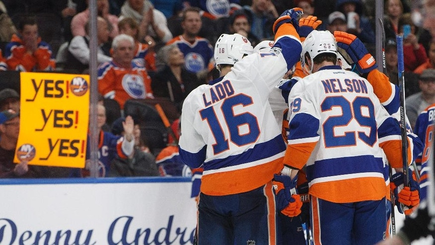 The New York Islanders celebrate a goal against the Edmonton Oilers during third period NHL hockey action in Edmonton, Alberta, on Tuesday, March 7, 2017. (Jason Franson/The Canadian Press via AP)