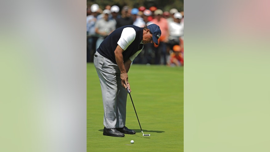 Phil Mickelson, of United States, tees off on the 4th hole during the final round of the Mexico Championship at the Chapultepec Golf Club in Mexico City, Sunday, March 5, 2017. All but one of the world's top 50 golfers are contesting the World Golf Championship PGA event, which this year relocated to Mexico City from the Trump National Doral Resort in Florida. (AP Photo/Christian Palma)