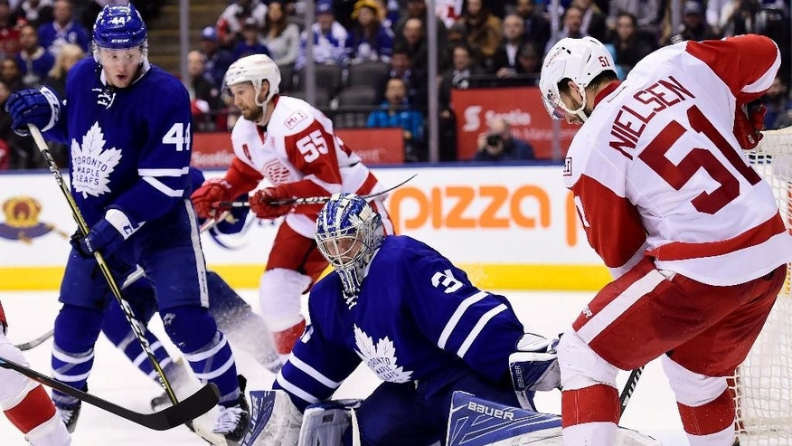 Toronto Maple Leafs goalie Frederik Andersen (31) makes a save on Detroit Red Wings' Frans Nielsen (51) as the Leafs' Morgan Rielly (44) looks on during third period NHL hockey action in Toronto on Tuesday, March 7, 2017. (Frank Gunn/The Canadian Press via AP)
