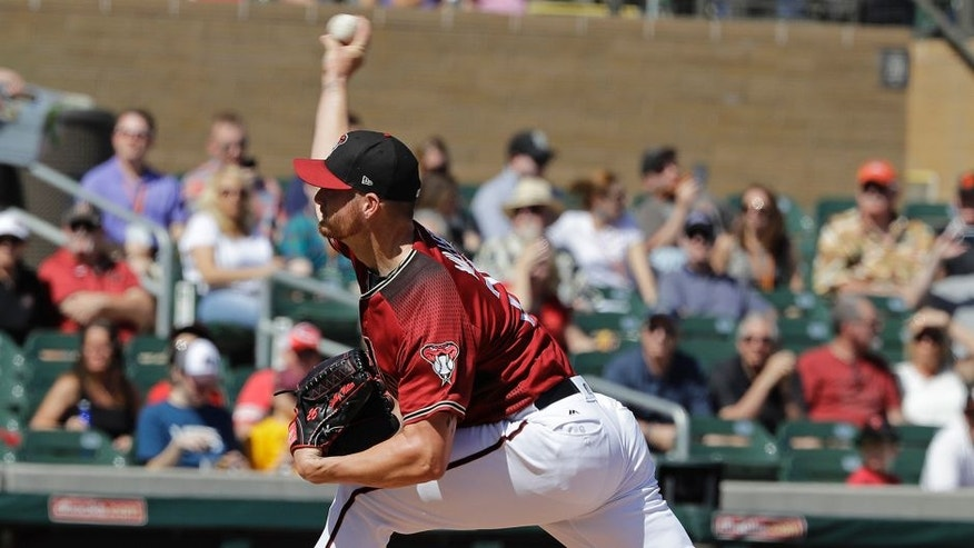 Arizona Diamondbacks' Shelby Miller throws during the first inning of a spring training baseball game against the Oakland Athletics, Tuesday, March 7, 2017, in Scottsdale, Ariz. (AP Photo/Darron Cummings)