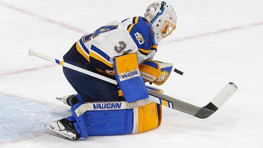 St. Louis Blues goalie Jake Allen stops a shot during the first period of an NHL hockey game against the Minnesota Wild, Tuesday, March 7, 2017, in St. Paul, Minn. (AP Photo/Jim Mone)