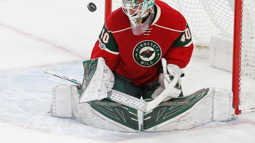 Minnesota Wild goalie Devan Dubnyk deflects a shot during the first period of an NHL hockey game against the St. Louis Blues, Tuesday, March 7, 2017, in St. Paul, Minn. (AP Photo/Jim Mone)