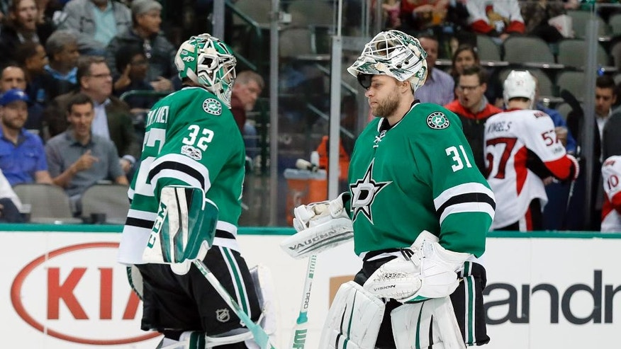 Dallas Stars' Kari Lehtonen (32) of Finland and Antti Niemi (31) of Finland tap each others leg pads as Lehtonen is replaced by Niemi in the second period of an NHL hockey game against the Ottawa Senators in Dallas, Wednesday, March 8, 2017. (AP Photo/Tony Gutierrez)