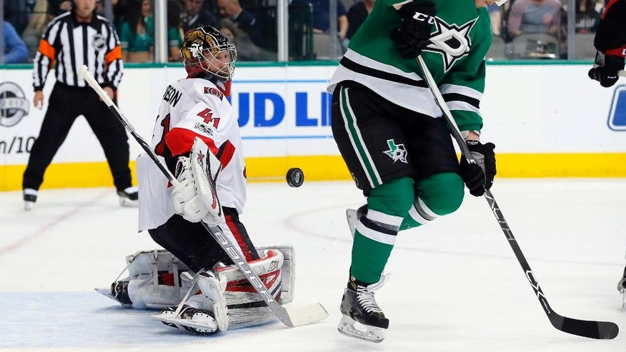 Ottawa Senators goalie Craig Anderson (41) defends against a shot that deflected off Dallas Stars' Cody Eakin (20) during the first period of an NHL hockey game in Dallas, Wednesday, March 8, 2017. (AP Photo/Tony Gutierrez)