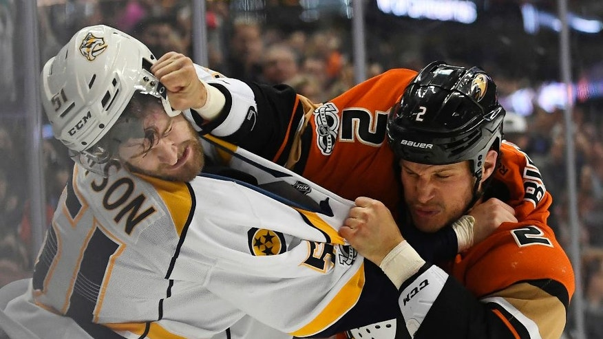 Nashville Predators left wing Austin Watson, left, fights with Anaheim Ducks defenseman Kevin Bieksa during the first period of an NHL hockey game, Tuesday, March 7, 2017, in Anaheim, Calif. (AP Photo/Mark J. Terrill)