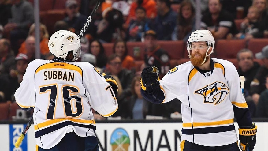 Nashville Predators defenseman Ryan Ellis, right, celebrates his goal with defenseman P.K. Subban during the first period of an NHL hockey game against the Anaheim Ducks, Tuesday, March 7, 2017, in Anaheim, Calif. (AP Photo/Mark J. Terrill)