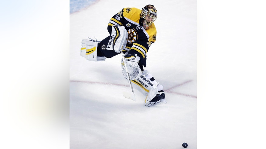 Boston Bruins goalie Tuukka Rask (40) skates out of the crease to clear the puck during the first period of an NHL hockey game against the Detroit Red Wings in Boston, Wednesday, March 8, 2017. (AP Photo/Charles Krupa)