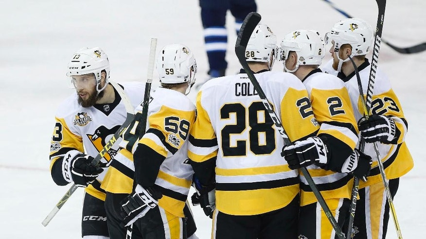 Nick Bonino (13) and the Pittsburgh Penguins celebrate Bonino's goal against the Winnipeg Jets during the first period of an NHL hockey game Wednesday, March 8, 2017, in Winnipeg, Manitoba. (John Woods/The Canadian Press via AP)