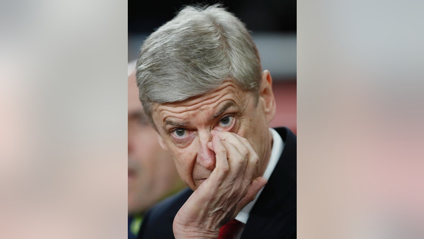 Arsenal manager Arsene Wenger gestures during the Champions League round of 16 second leg soccer match between Arsenal and Bayern Munich at the Emirates Stadium in London, Tuesday, March 7, 2017. (AP Photo/Kirsty Wigglesworth)