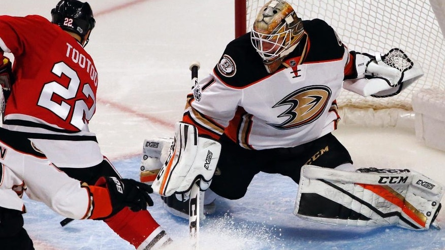 Anaheim Ducks goalie Jonathan Bernier, right, blocks a shot by Chicago Blackhawks right wing Jordin Tootoo during the second period of an NHL hockey game Thursday, March 9, 2017, in Chicago. (AP Photo/Nam Y. Huh)