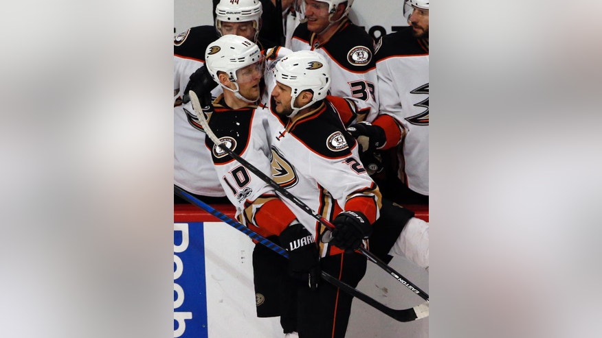 Anaheim Ducks right wing Corey Perry (10) celebrates with defenseman Kevin Bieksa (2) after scoring his goal against the Chicago Blackhawks during the second period of an NHL hockey game Thursday, March 9, 2017, in Chicago. (AP Photo/Nam Y. Huh)