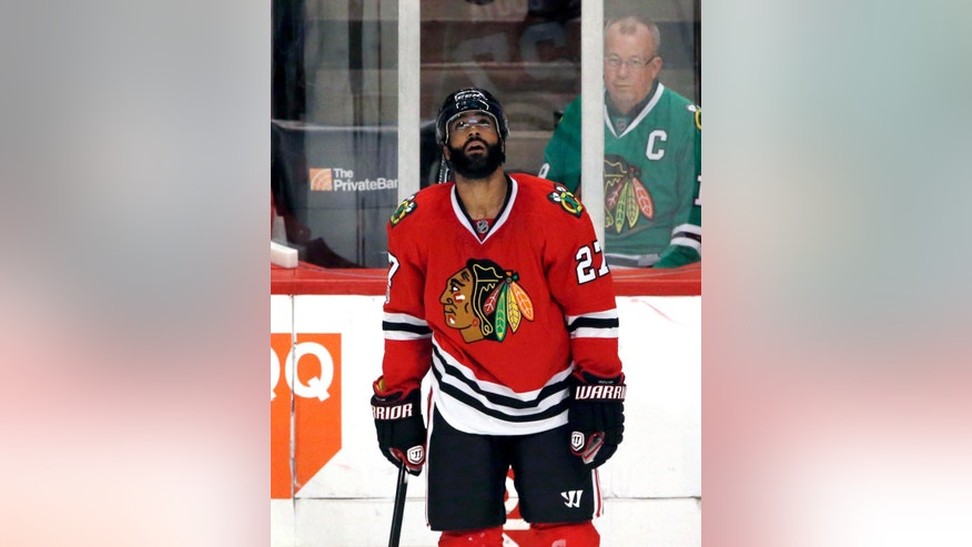 Chicago Blackhawks defenseman Johnny Oduya looks at the scoreboard after Anaheim Ducks right wing Corey Perry scored a goal during the second period of an NHL hockey game Thursday, March 9, 2017, in Chicago. (AP Photo/Nam Y. Huh)