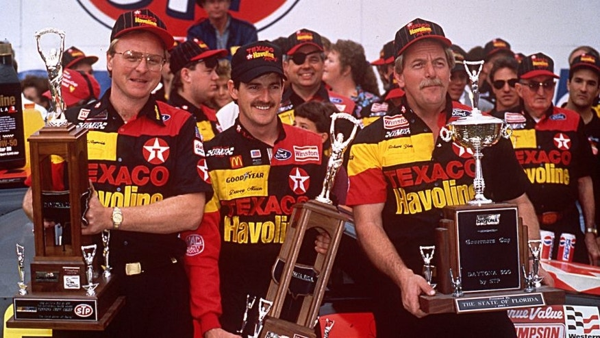 DAYTONA BEACH, FL — February 16, 1992: Davey Allison (C) celebrates in victory lane at Daytona International Speedway with crew chief Larry McReynolds (L) and car owner Robert Yates (R) after winning the Daytona 500 NASCAR Cup race. (Photo by ISC Images & Archives via Getty Images)