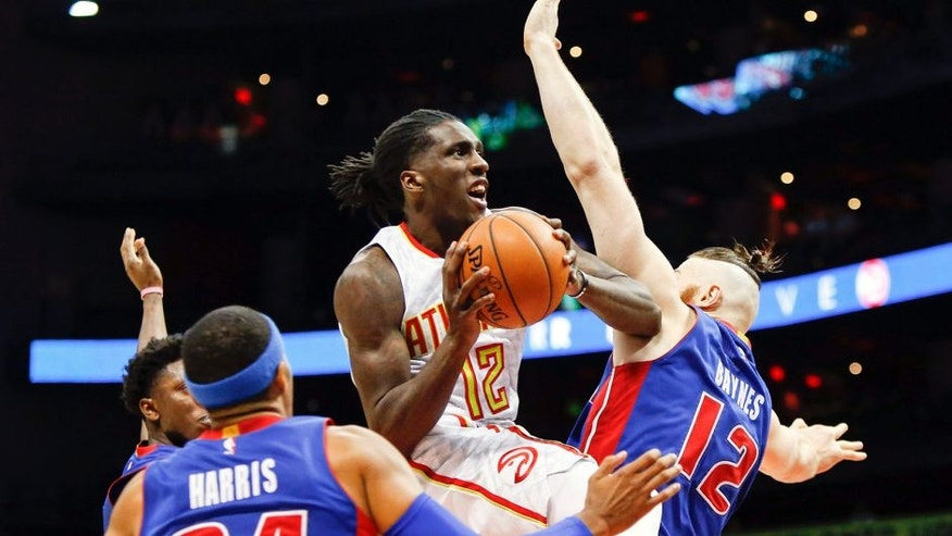 Oct 13, 2016; Atlanta, GA, USA; Atlanta Hawks forward Taurean Prince (12) shoots the ball against the Detroit Pistons in the fourth quarter at Philips Arena. The Pistons defeated the Hawks 99-94. Mandatory Credit: Brett Davis-USA TODAY Sports