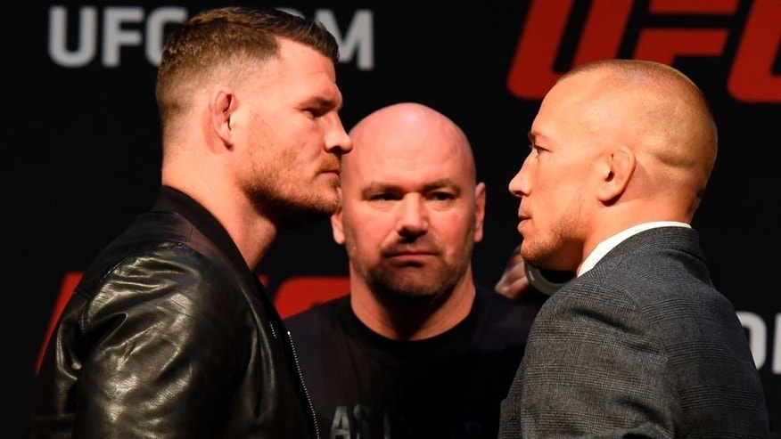 LAS VEGAS, NV - MARCH 03: (L-R) UFC middleweight champion Michael Bisping of England faces off against Georges St-Pierre of Canada during the UFC press conference at T-Mobile arena on March 3, 2017 in Las Vegas, Nevada. (Photo by Josh Hedges/Zuffa LLC/Zuffa LLC via Getty Images)