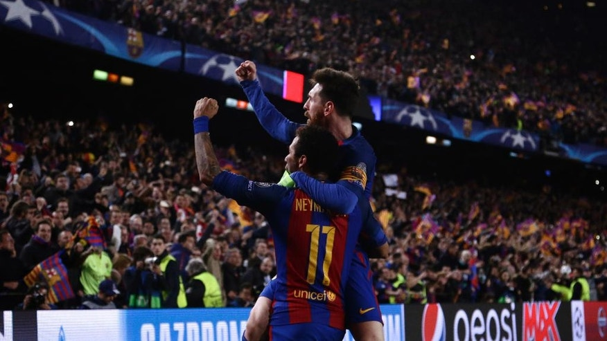 Barcelona's Lionel Messi celebrates with Neymar their victory during the Champion League round of 16, second leg soccer match against Paris Saint Germain at the Camp Nou stadium in Barcelona, Spain, Wednesday March 8, 2017. (AP Photo/Emilio Morenatti)