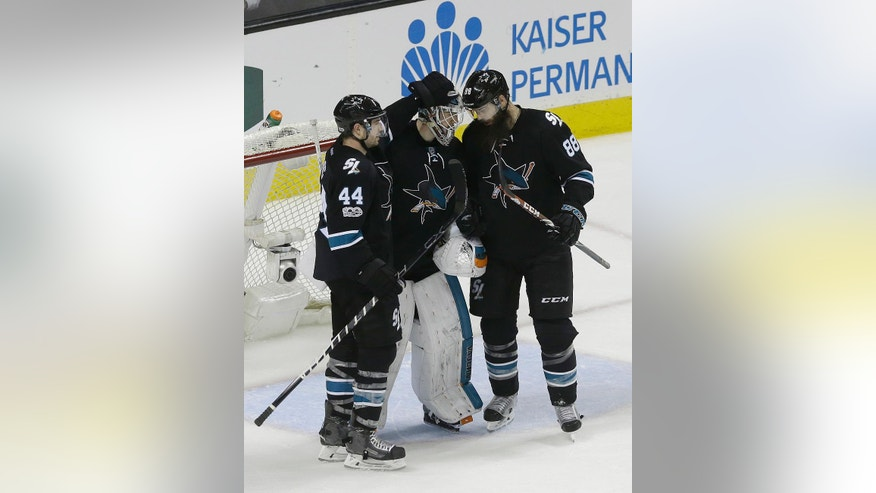 San Jose Sharks goalie Martin Jones, center, celebrates with defensemen Marc-Edouard Vlasic (44) and Brent Burns (88) after the Sharks defeated the Washington Capitals 4-2 in an NHL hockey game in San Jose, Calif., Thursday, March 9, 2017. (AP Photo/Jeff Chiu)