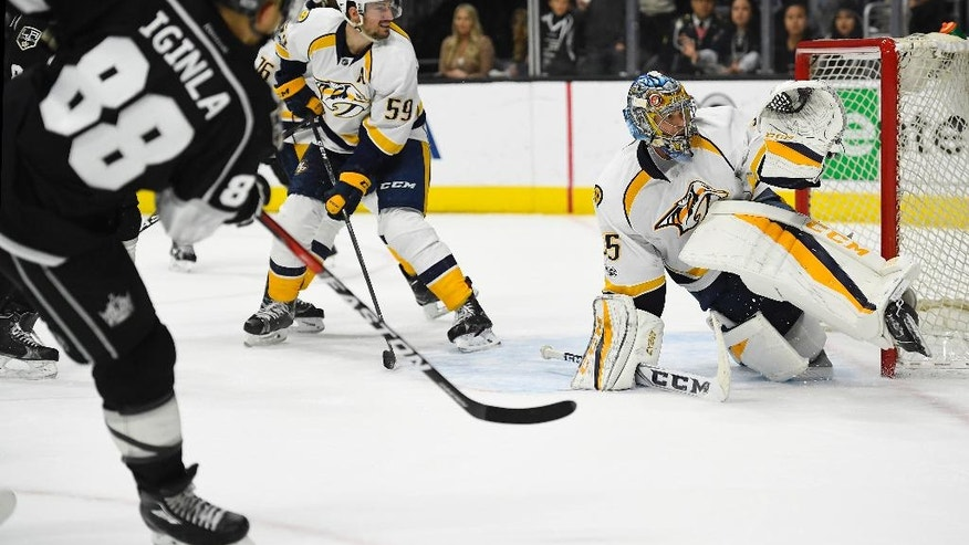 Los Angeles Kings right wing Jarome Iginla, left, scores on Nashville Predators goalie Pekka Rinne, of Finland, in overtime of an NHL hockey game, Thursday, March 9, 2017, in Los Angeles. The Kings won 3-2. (AP Photo/Mark J. Terrill)
