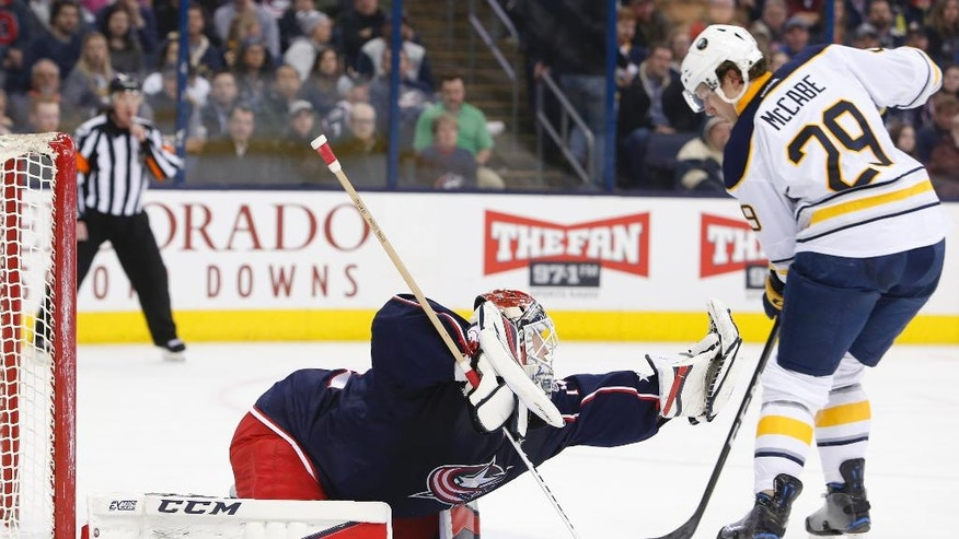 Columbus Blue Jackets' Sergei Bobrovsky, left, of Russia, makes a save in front of Buffalo Sabres' Jake McCabe during the first period of an NHL hockey game Friday, March 10, 2017, in Columbus, Ohio. (AP Photo/Jay LaPrete)