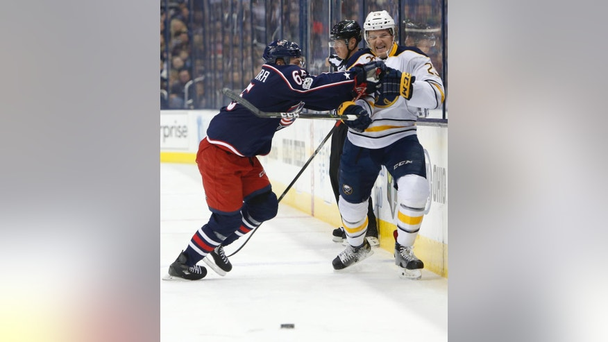 Columbus Blue Jackets' Markus Nutivaara, left, of Finland, checks Buffalo Sabres' Jake McCabe during the first period of an NHL hockey game Friday, March 10, 2017, in Columbus, Ohio. (AP Photo/Jay LaPrete)