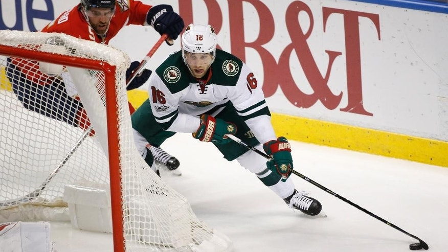 Minnesota Wild left wing Jason Zucker (16) and Florida Panthers defenseman Aaron Ekblad (5) battle for the puck during the first period of an NHL hockey game, Friday, March 10, 2017, in Sunrise, Fla. (AP Photo/Wilfredo Lee)