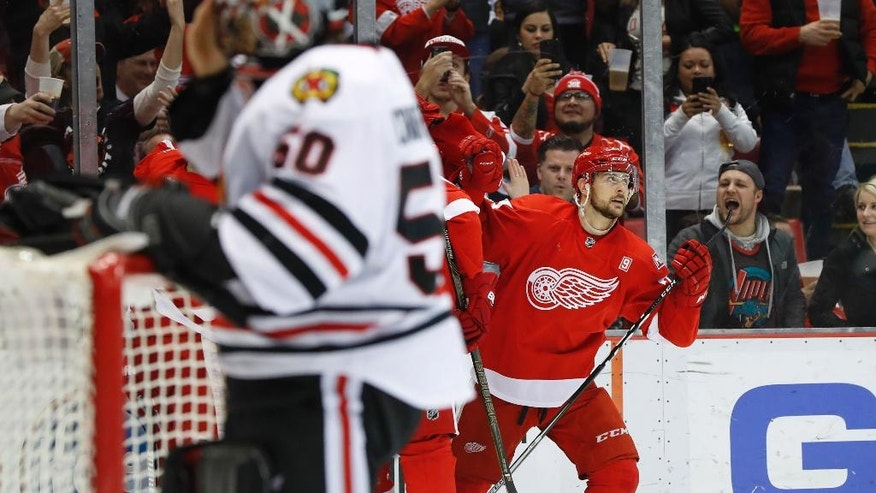 Detroit Red Wings left wing Tomas Tatar (21) watches the replay after scoring on Chicago Blackhawks goalie Corey Crawford, left, in the second period of an NHL hockey game Friday, March 10, 2017, in Detroit. (AP Photo/Paul Sancya)