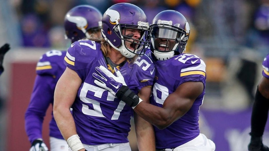 Dec 28, 2014; Minneapolis, MN, USA; Minnesota Vikings linebacker Audie Cole (57) celebrates his defensive play against the Chicago Bears with Xavier Rhodes in the fourth quarter at TCF Bank Stadium. The Vikings win 13-9. Mandatory Credit: Bruce Kluckhohn-USA TODAY Sports