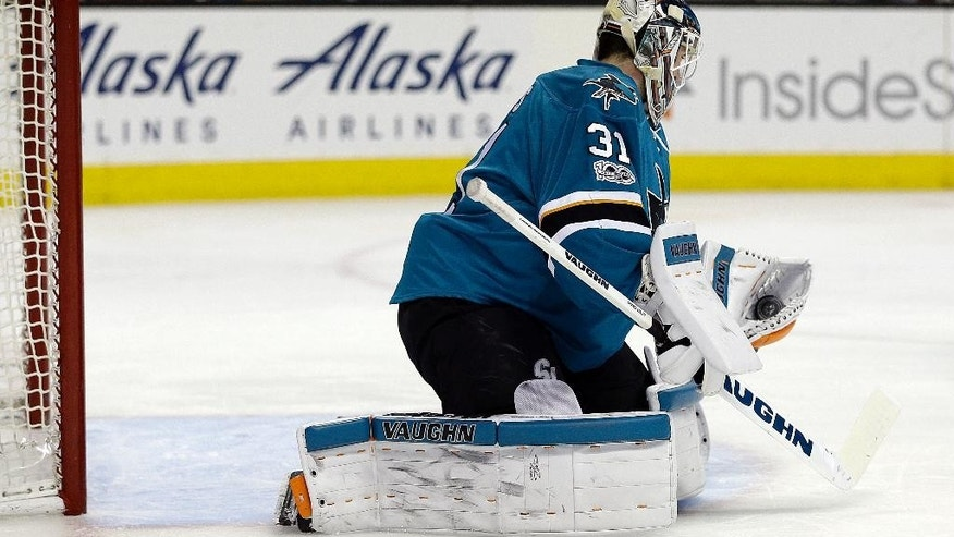 San Jose Sharks goalie Martin Jones makes a save on a shot from the Nashville Predators during the first period of an NHL hockey game Saturday, March 11, 2017, in San Jose, Calif. (AP Photo/Ben Margot)