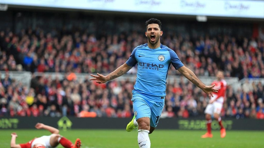 Manchester City's Sergio Aguero celebrates scoring his side's second goal of the game during the English FA Cup quarter final at the Riverside Stadium in Middlesbrough, England, Saturday March 11, 2017. (Mike Egerton/PA via AP)