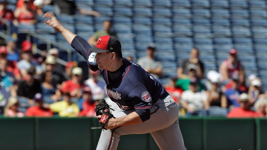 Minnesota Twins pitcher Trevor May delivers to the Philadelphia Phillies during the first inning of a spring training baseball game Friday, March 3, 2017, in Clearwater, Fla. (AP Photo/Chris O'Meara)