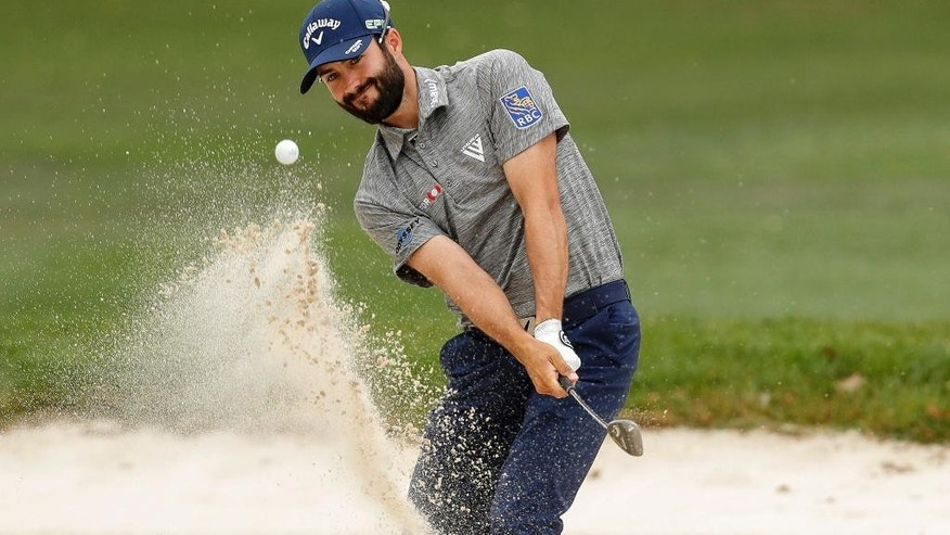 Adam Hadwin chips onto the first green during the final round of the Valspar Championship golf tournament Sunday, March 12, 2017, at Innisbrook in Palm Harbor, Fla. (AP Photo/Mike Carlson)