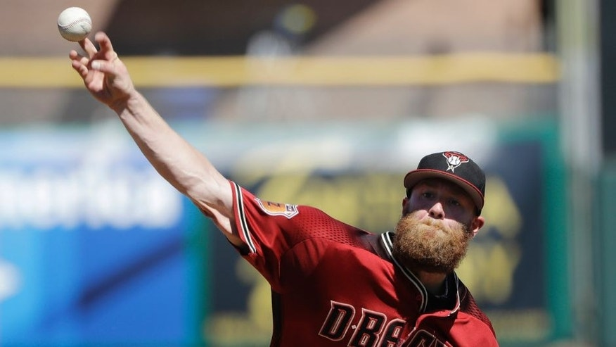Arizona Diamondbacks' Archie Bradley throws during the first inning of a spring training baseball game against the San Francisco Giants, Sunday, March 12, 2017, in Scottsdale, Ariz. (AP Photo/Darron Cummings)