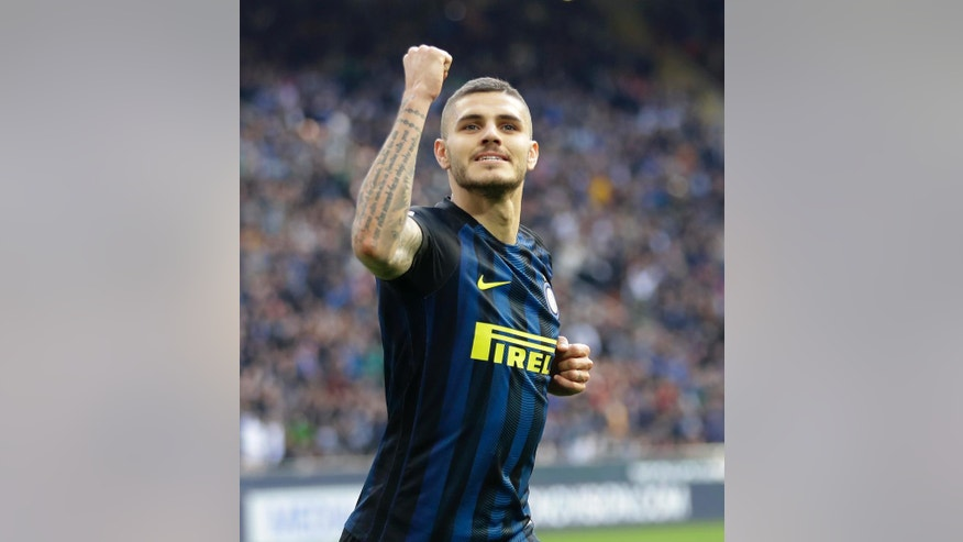 Inter Milan's Mauro Icardi celebrates after scoring during the Serie A soccer match between Inter Milan and Atalanta at the San Siro stadium in Milan, Italy, Sunday, March 12, 2017. (AP Photo/Antonio Calanni)