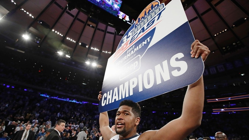 Villanova's Kris Jenkins celebrates after the Wildcats won the Big East tournament against Creighton Saturday, March 11, 2017.