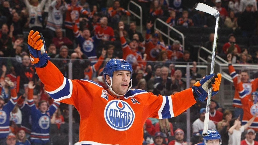 Edmonton Oilers left wing Milan Lucic (27) celebrates a goal against the Montreal Canadiens during the second period of an NHL hockey game Sunday, March 12, 2017, in Edmonton, Alberta. (Jason Franson/The Canadian Press via AP)
