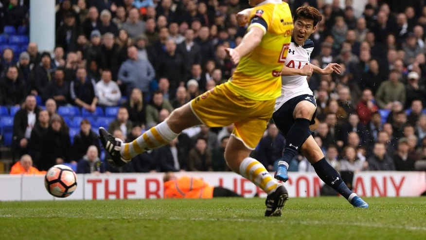 Tottenham's Heung-Min Son, right, scores his third goal during the English FA Cup quarterfinal soccer match between Tottenham Hotspur and Millwall FC at White Hart Lane stadium in London, Sunday, March 12, 2017. (AP Photo/Matt Dunham)