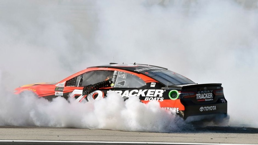 2017 Monster Energy NASCAR Cup Series - Kobalt 400 Las Vegas Motor Speedway - Las Vegas, NV USA Sunday 12 March 2017 Martin Truex Jr, Bass Pro Shops/TRACKER BOATS Toyota Camry celebrates his win with a burnout World Copyright: Nigel Kinrade/LAT Images ref: Digital Image 17LAS1nk07779